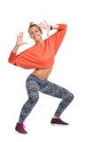 Smiling Zumba Instructor. Smiling young female dancing zumba. Full length studio shot isolated on white Royalty Free Stock Image