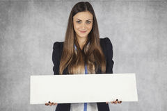 Smilingbusiness woman holds a place for your ad Royalty Free Stock Photography