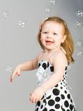 Little girl with soap bubbles Royalty Free Stock Photography