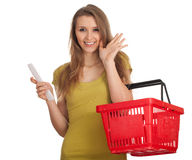 Smilinwoman  checking purchases list, waving hello Stock Images