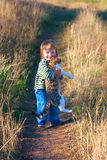 Smill child hold cat in hands Royalty Free Stock Image