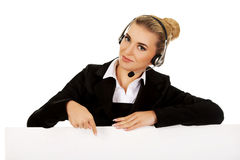 Smille call center woman holding empty banner. Stock Image