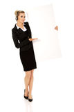 Smille call center woman holding empty banner. Royalty Free Stock Photography