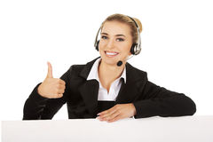Smille call center woman holding empty banner and showing OK Royalty Free Stock Photos