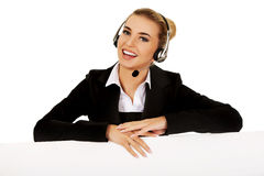 Smille call center woman holding empty banner. Stock Images