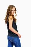 蓝色牛仔裤的愉快的时尚女孩 免版税库存图片