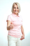 Smilling attractive middle aged woman showing thumbs up, okay. Isolated Royalty Free Stock Photography