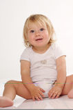 Smilling blonde little girl in white T-shirt Stock Image
