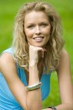 Smilling blonde woman. Smilling blonde beautiful woman in the park Stock Images