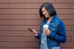 Smilling brunette woman with smartphone Stock Photo