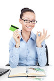Smilling businesswoman with credit card in hand Stock Image
