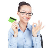 Smilling businesswoman with credit card in hand Royalty Free Stock Images