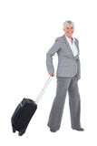 Smilling businesswoman with her luggage Royalty Free Stock Photography