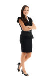 Smilling businesswoman standing with crossed arms Stock Images