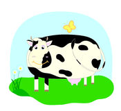 Smilling  cow. Cow on the grass with butterfly and chamomiles Royalty Free Stock Photo