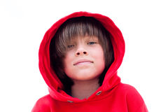 Smilling face. Boy looking at lens, smilling friendly, wearsp red hood royalty free stock photo