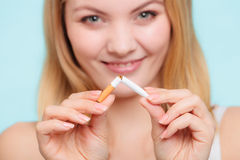 Smilling girl is breaking cigarette Royalty Free Stock Images