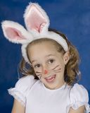 Smilling girl with bunny Stock Photos