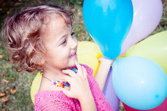 Smilling girl   with colorful  balloons Stock Photo