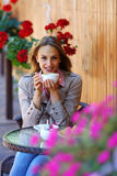 Smilling girl holding cup coffee on the table Stock Photo