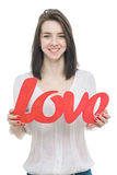 Smilling girl, holding title Love in her hands Royalty Free Stock Image