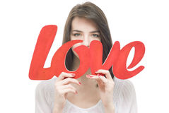 Smilling girl, holding title Love in her hands Royalty Free Stock Images
