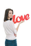 Smilling girl, holding title Love in her hands Royalty Free Stock Photography