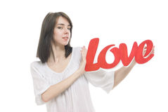 Smilling girl, holding title Love in her hands Stock Image