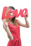 Smilling girl, holding title Love in her hands Stock Images