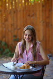 Smilling girl looking in diary with pen Stock Images