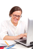 Smilling girl looking in laptop Royalty Free Stock Images