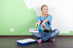 Smilling girl with paint tools Stock Photography