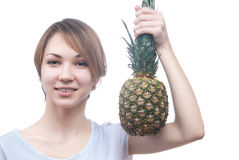 Smilling girl with pinaple Stock Images