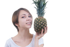 Smilling girl with pinaple Royalty Free Stock Photos