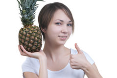 Smilling girl with pinaple showing ok Stock Image