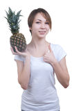 Smilling girl with pinaple showing ok Stock Photos