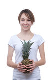 Smilling girl with pineapple showing ok Royalty Free Stock Photography