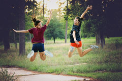Smilling when jumping in the forrest. Teenagers jumping in a forrest in Houston, Texas, USA Royalty Free Stock Photos