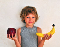 Smilling kid with fruits Stock Photo