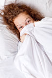 Smilling lady in the bed Stock Photos