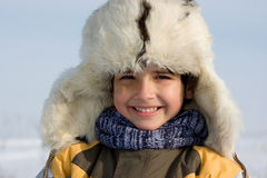 Smilling little boy in the fur-cap Stock Image