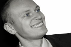 Smilling man. On black and white background Stock Photography