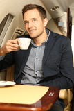 Smilling man holding coffe on board Stock Photography