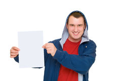 Smilling man in hood hold white blank. Isolated on white Stock Photography