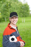 Smilling man with soccer ball. Outdoors Royalty Free Stock Photo