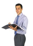 Smilling reading business man. Attractive young business amn reading Royalty Free Stock Photos