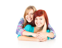Smilling two teenage girls, friends. Two teenage girls, friends leaning on the white background Stock Photo