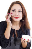 Smilling woman with face cream Stock Photography