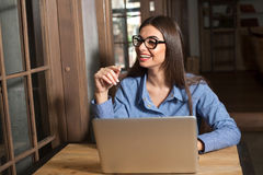 Smilling woman, laptop and glasses Royalty Free Stock Image