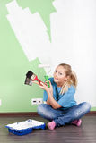 Smilling woman with paint tools Royalty Free Stock Images
